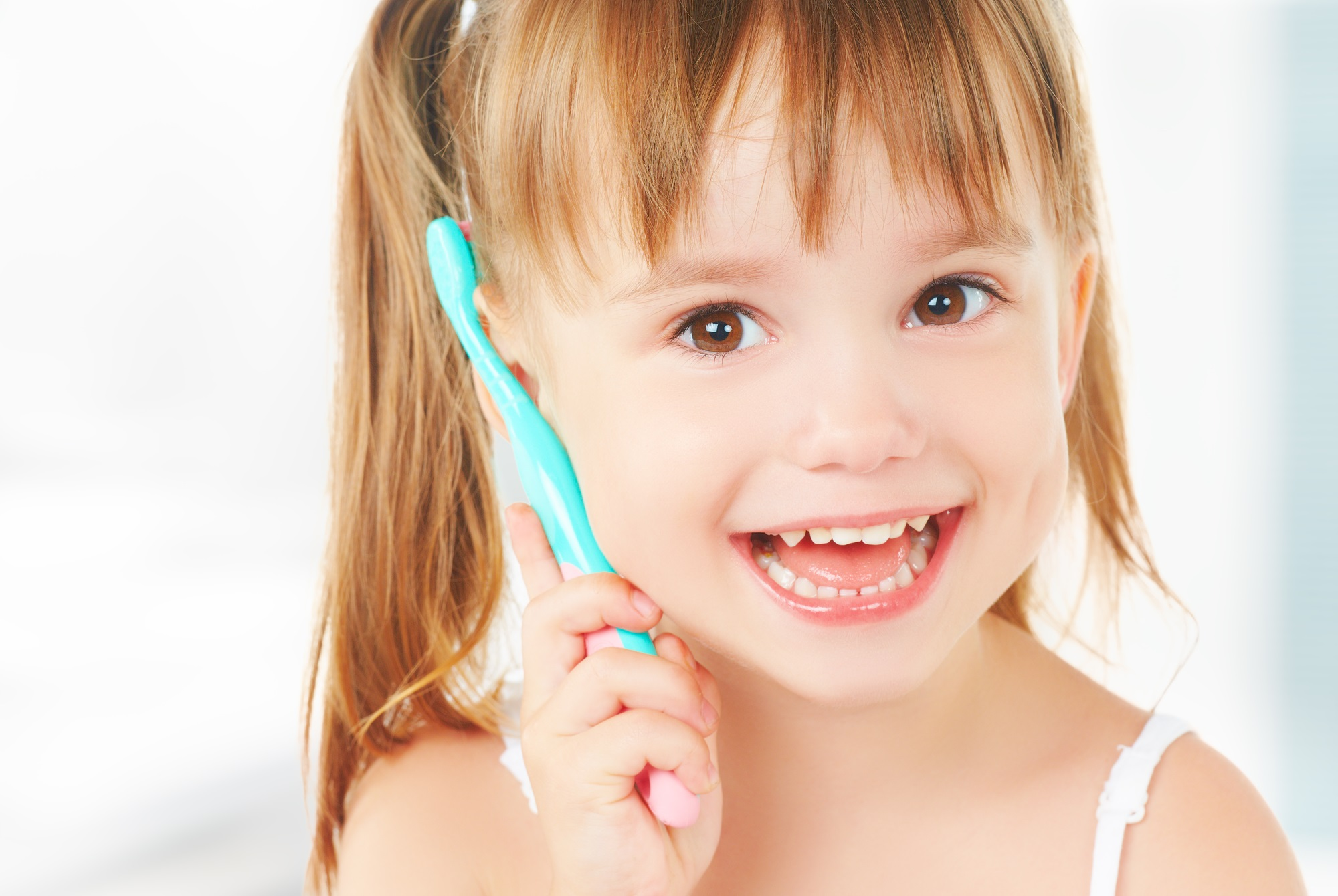 dental hygiene. happy little girl brushing her teeth