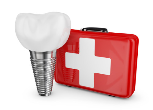 dental implant and a red suitcase with white cross