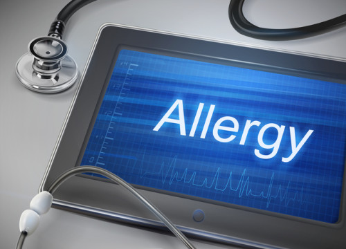 allergy word display on tablet over table